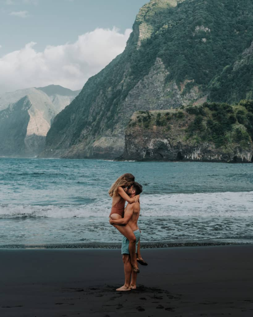 couple on a black beach in seixal what to see on madeira