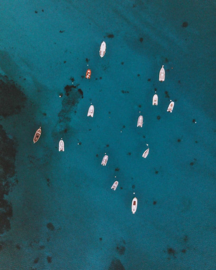boats seen from a drone sardinia practical information
